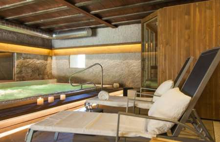 Can Barracas, a detail of the spa, with heated pool, Jacuzzi, sauna, and steam shower