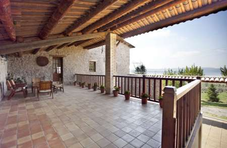 Can Rovira, the huge balcony over the patio behind the house